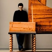 Noisy dissent disrupts a harpsichord recital