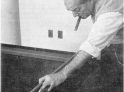 Heitor-Villa-Lobos-playing-billiards-while-smoking-a-cigar-