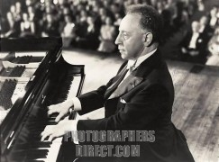Arthur Rubinstein playing Steinway piano keyboard in front of audience in 1947 film 'Carnegie Hall'