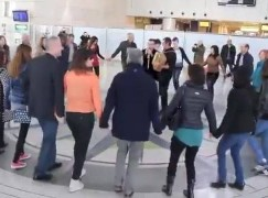 At this airport they make you sing and dance