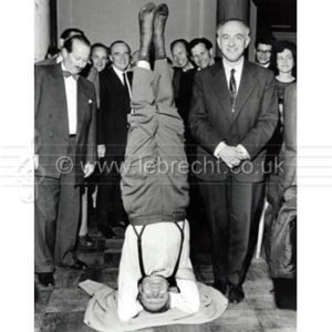 Yehudi Menuhin in yoga position on his head with