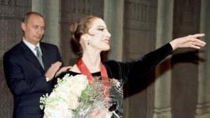 File photo of Vladimir Putin clapping for prima ballerina Maya Plisetskaya at the Bolshoi Theatre in Moscow