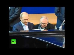 Putin's not getting any better at piano playing