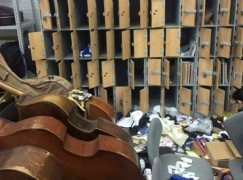 Orchestra say president's security men trashed their lockers