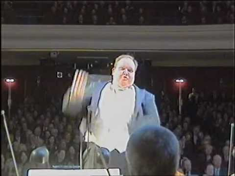 Remember the dancing conductor? He's back with a singing version
