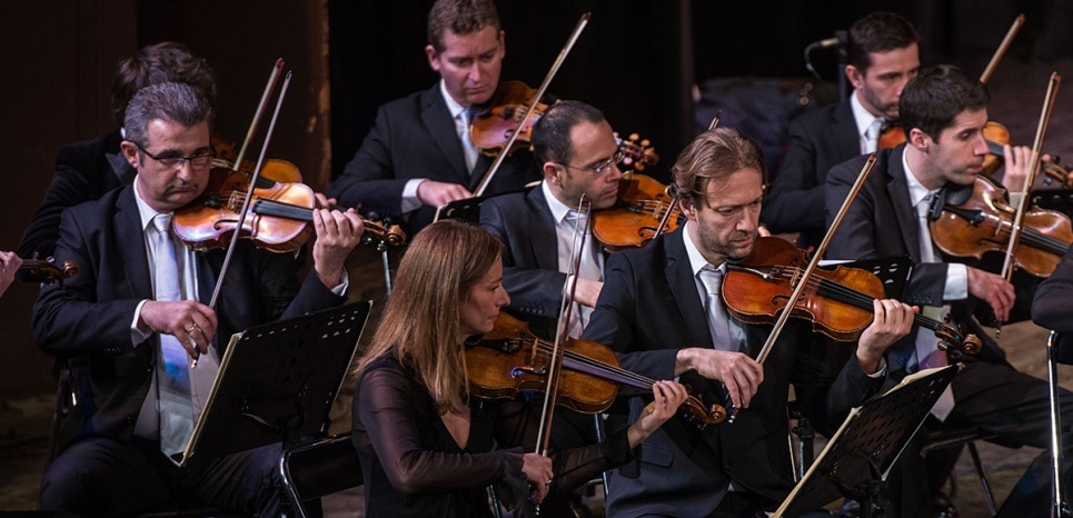 TUNIS, TUNISIA - FEBRUARY 20: Violinist Anne Gravoin (Front L) performs as Alma Chamber Orchestra presents a concert conducted by Lionel Bringuier at municipality theatre hall in Tunis, Tunisia on February 20, 2015. Ahmet Izgi / Anadolu Agency