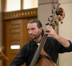 Double-bass finds dead body: Should I tell the orchestra?
