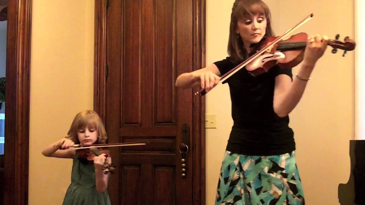 Mother and child play Bach's double concerto