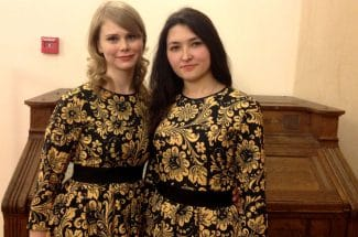 Two harp students are fined for playing in the street