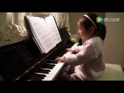 3-year-old-playing-piano