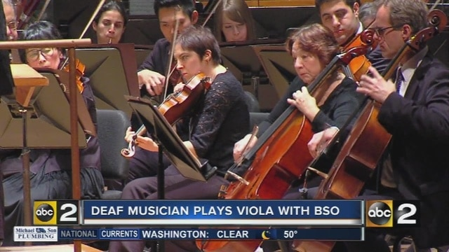 deaf_musician_plays_viola_with_baltimore_0_49918386_ver1-0_640_480