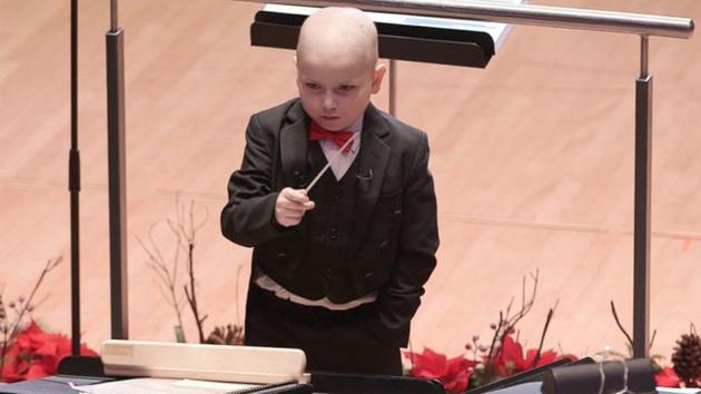 Watch: Boy with leukemia conducts symphony orchestra