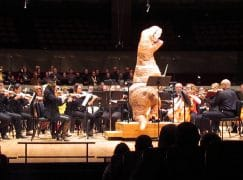 This orchestra is conducted by a dinosaur