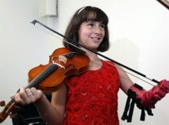 Girl plays violin with new artificial hand