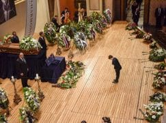 Maestro's coffin is displayed on concert stage