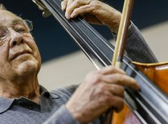 At 81, Tommy has been playing bass in this orchestra for 65 years