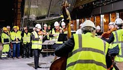 Orchestra goes 65 feet underground to play for construction workers