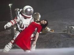 Scenes from La Bohème set in outer space