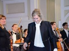 A woman conductor changes orchestras 'one note at a time'