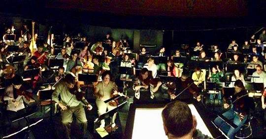 This orchestra will wave right back at you