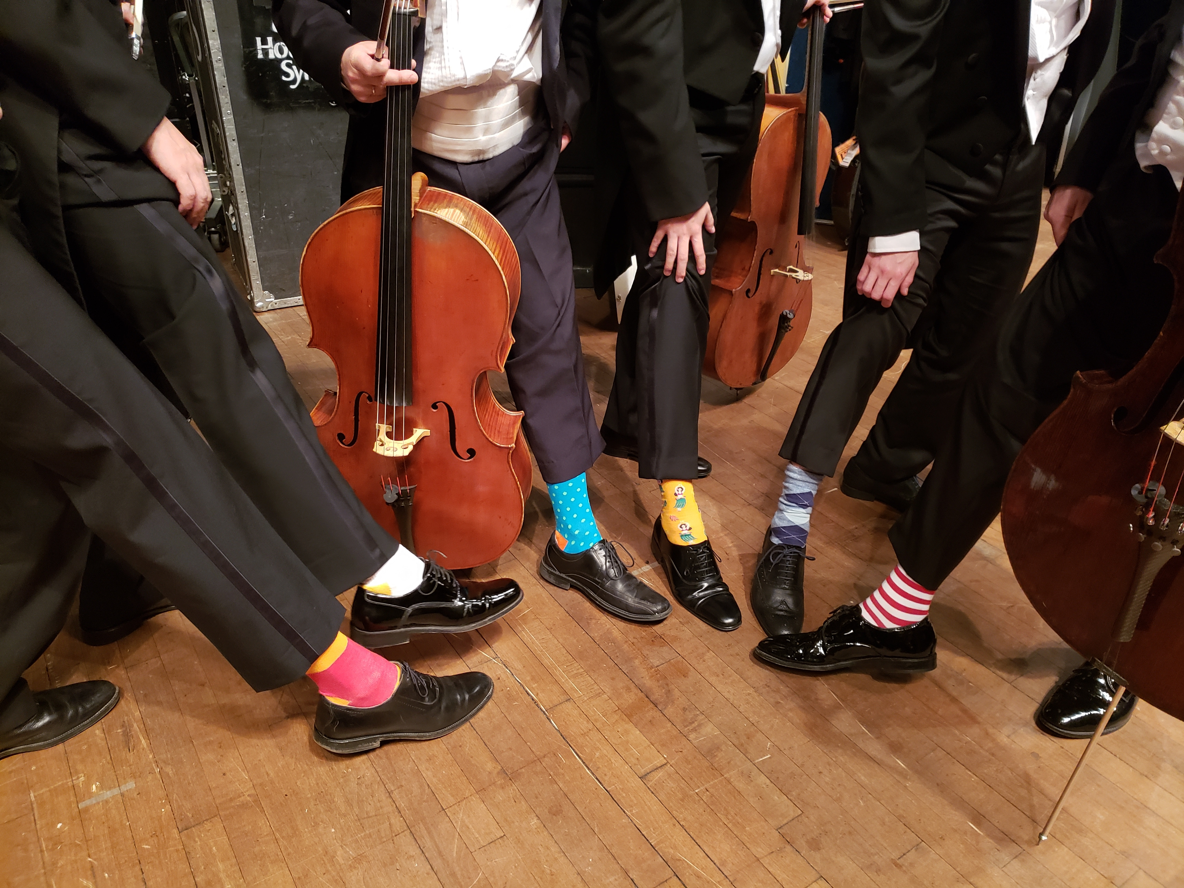 Symphony orchestra wears cheeky socks in honour of late President Bush