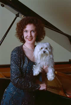 This pianist takes her puppy everywhere