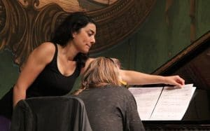 In Covid-era concerts, pity the poor page-turner