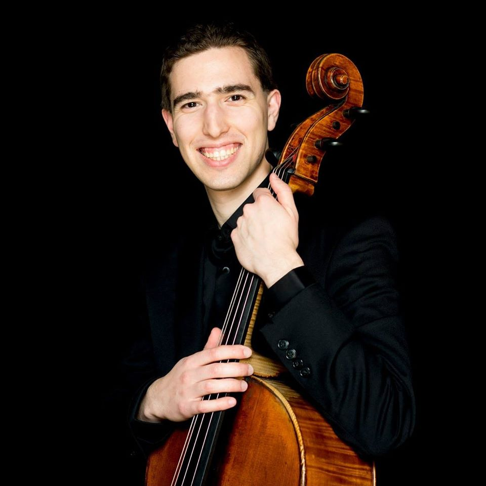 A cellist torn between two great orchestras
