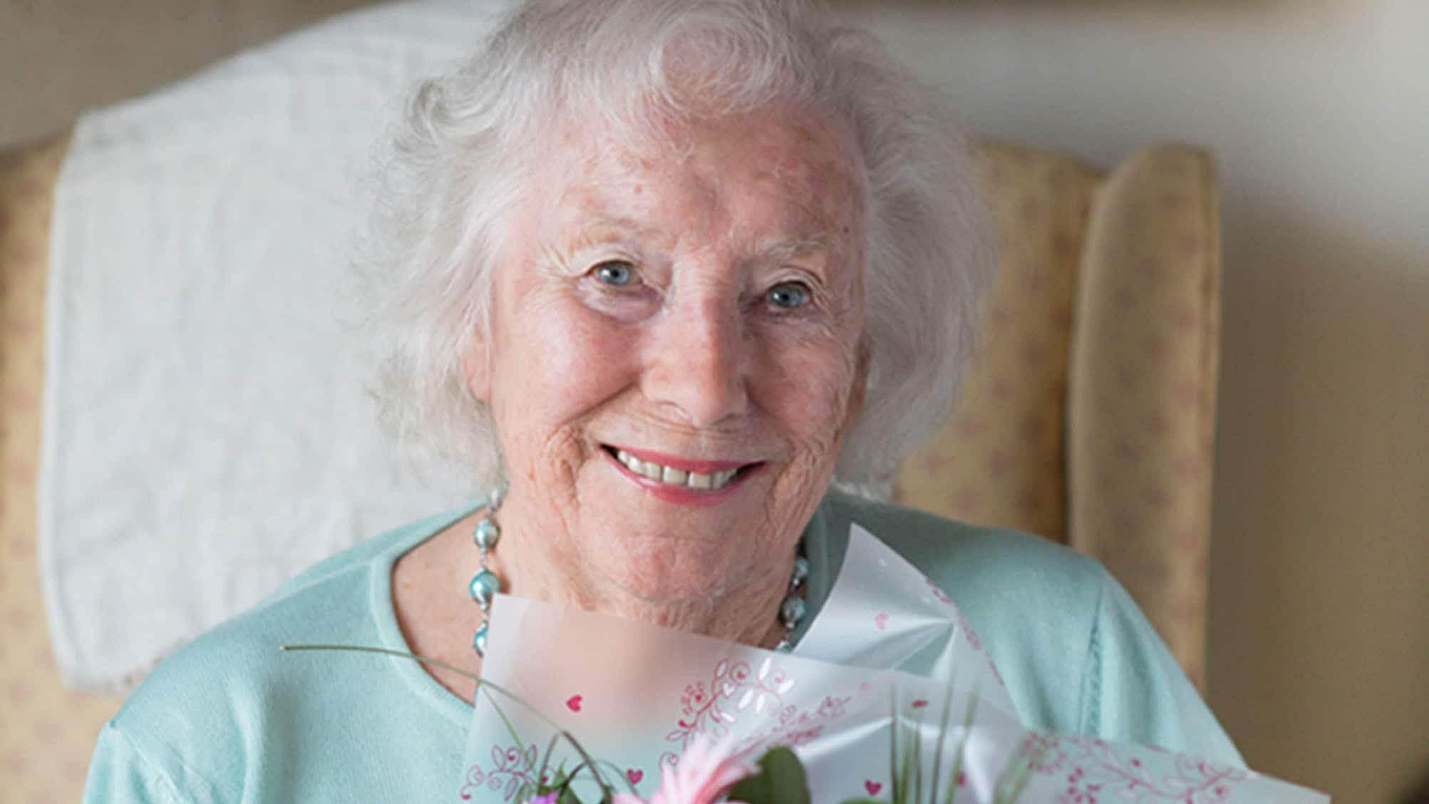 Dame Vera Lynn, 103, says 'keep smiling and keep singing'