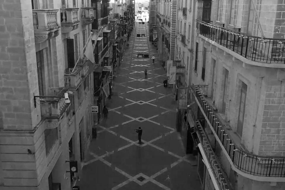 Image of our times: Orchestra plays at distance on an empty street