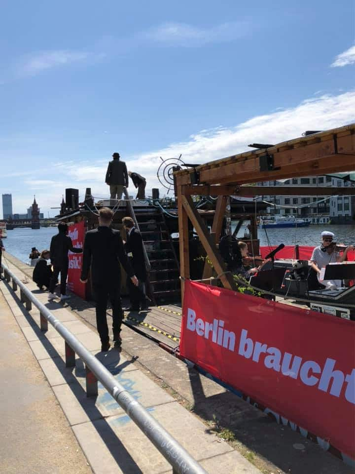 Berlin orchestra plays on a bus and a boat