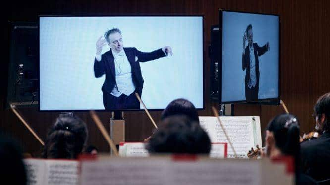 Covid madness: Orchestra plays to recorded conductor