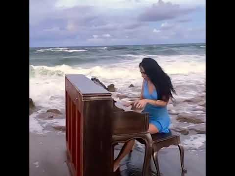 Ocean waves overwhelm a reckless pianist