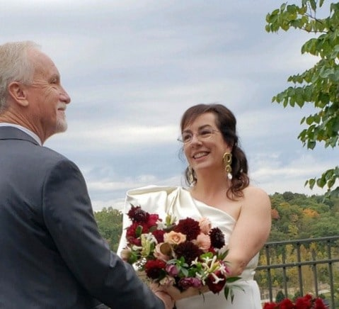 US orchestra chief balances budget, gets married, resumes rehearsal