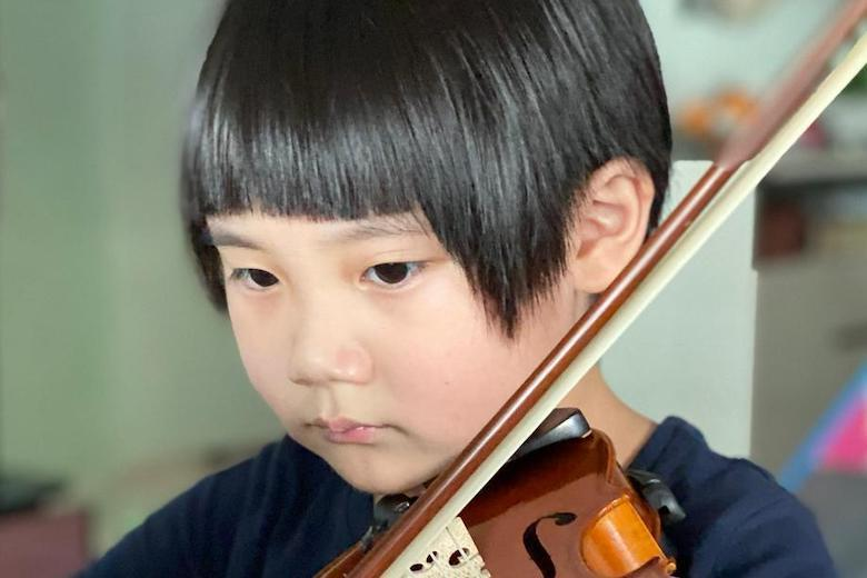 Child, 5, passes grade 8 violin before he can write
