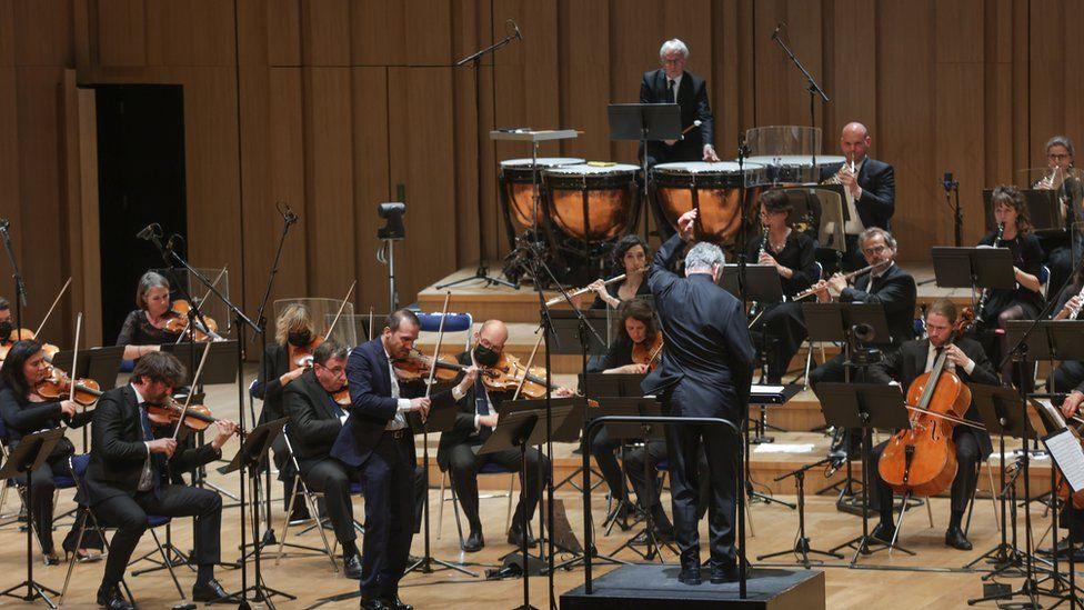 Conductor loses use of right arm while recovering from stroke