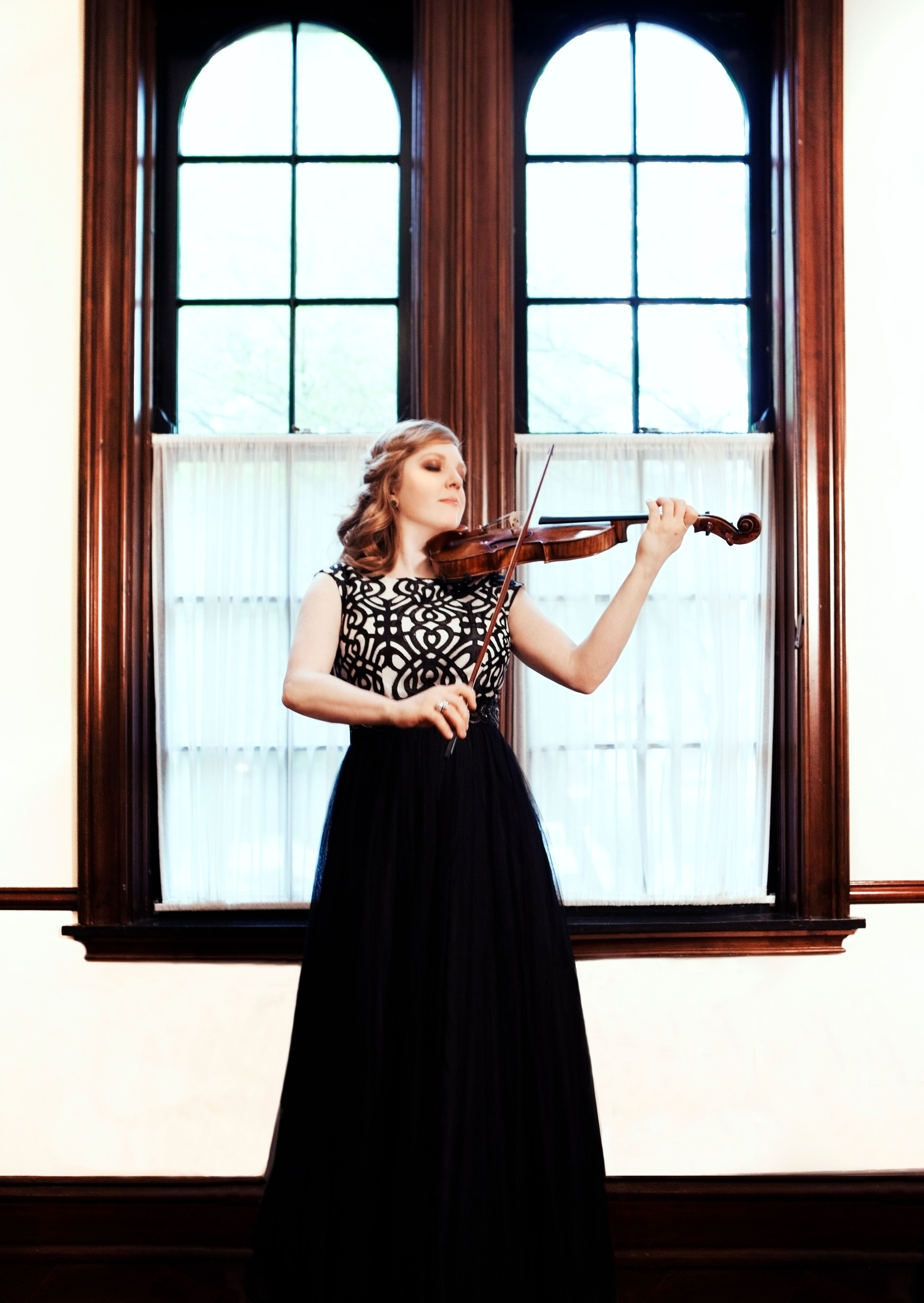 This violin star will now play sitting down